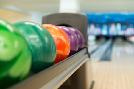 Rack Of Colorful Balls At A Bowling Alley photo