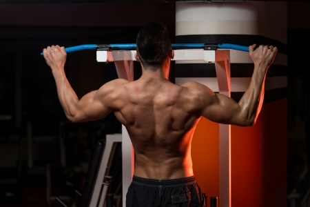 strenght: Muscular Young Man Exercising In Gym
