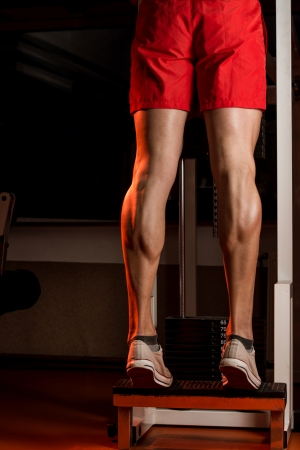 leg muscle fiber: Muscular Man Calves Stock Photo