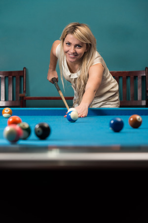 billiards hall: Female Playing Billiard Stock Photo