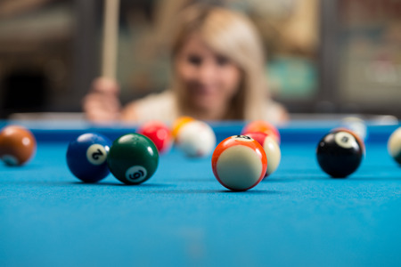 pool hall: Young Women Concentrate On Ball