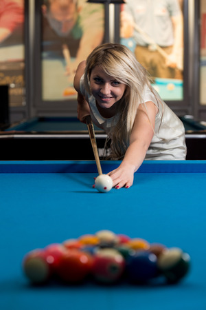 billiards hall: Young Women Lines Up A Shot
