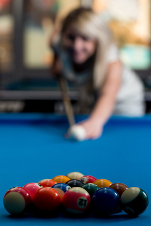 snooker hall: Female Playing Billiard Stock Photo