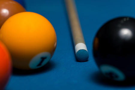 cue stick: Pool Table With Balls And Cue Stick Stock Photo