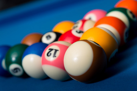 upperdeck view: Billiard Balls On Blue Cloth Stock Photo