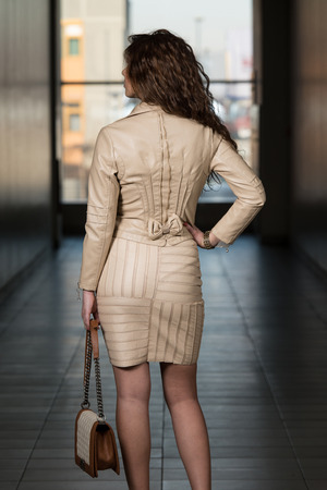 Girl From Behind In Leather Skirt And Jacket Stock Photo