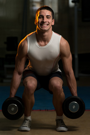squats: Squats With Dumbbells Stock Photo