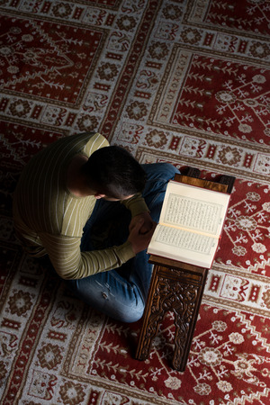 Muslim Man Is Reading The Koran photo