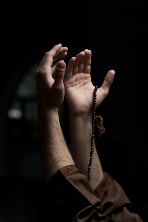 Hands Holding A Muslim Rosary In Mosque
