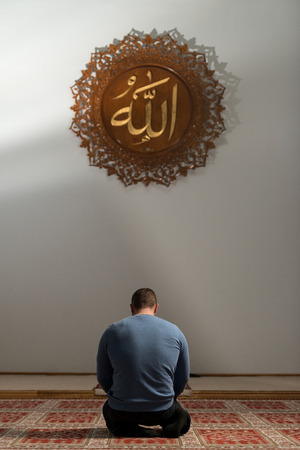 Muslim Men Is Praying In The Mosque 스톡 콘텐츠