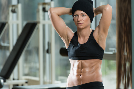 only the biceps: Portrait Of A Physically Fit Muscular Young Woman
