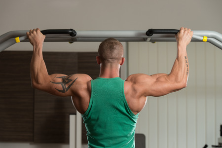 male athlete: Male Athlete Doing Pull Ups - Chin-Ups In The Gym