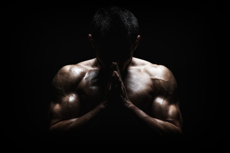 Muscular Man Praying - Spiritual Concentration Concept photo