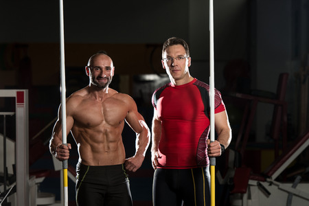 Portrait Of A Physically Fit Mature Men In A Healthy Club With Dramatic Lighting photo