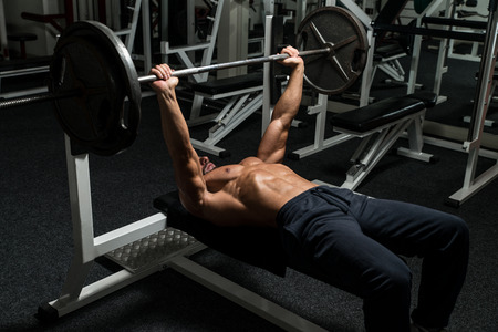 Mature Man In Gym Exercising On The Bench Press Stock Photo