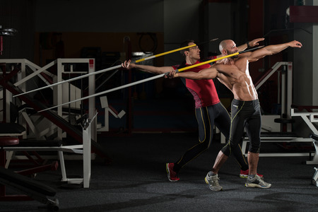 Side view Of Muscular Men Throwing Javelin photo