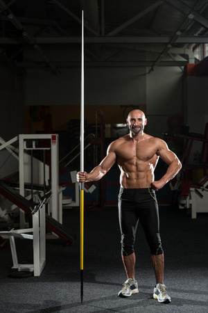 Portrait Of A Physically Fit Mature Male With Javelin photo
