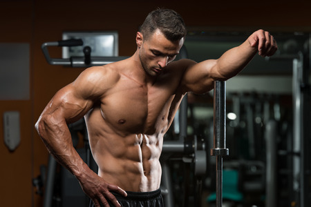 abdominal muscle: Portrait Of A Physically Fit Young Man Without A Shirt Stock Photo