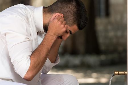 arab people: Muslim Man Preparing To Take Ablution In Mosque Stock Photo