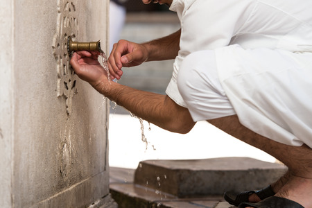 Muslim Man Preparing To Take Ablution In Mosque Stock Photo