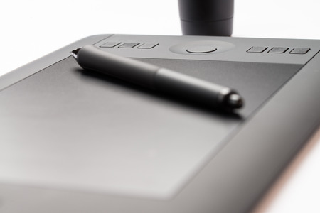 digitized: Drawing Tablet With Stylus On White Background