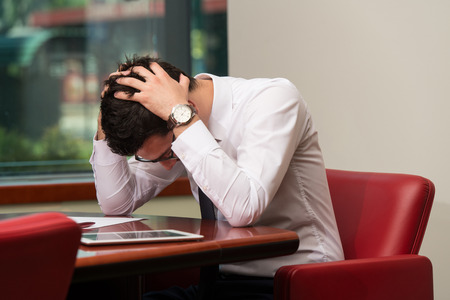 Young Business Man With Problems And Stress In The Office 스톡 콘텐츠