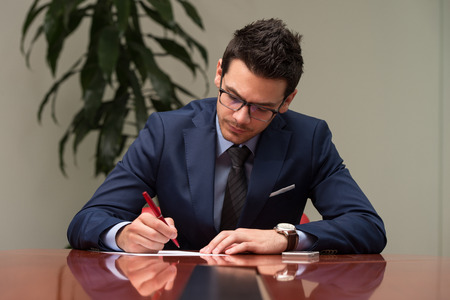 Businessman Writing A Letter - Notes Or Correspondence Or Signing A Document Or Agreement Stock Photo
