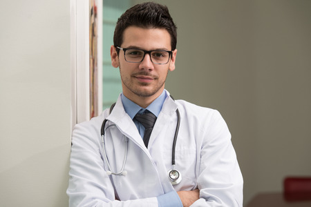 young male doctor: Portrait Of Smiling Young Male Doctor