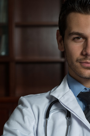 Portrait Of Smiling Young Male Doctor photo