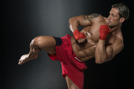 body bag: A Man With A Tattoo In Red Boxing Gloves - Boxing On Black Background - The Concept Of A Healthy Lifestyle - The Idea For The Film About Boxing