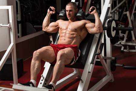 bodybuilding: Male Bodybuilder Doing Heavy Weight Exercise For Legs