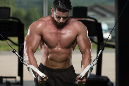 Bodybuilder Is Working On His Chest With Cable Crossover In Gym Stock Photo
