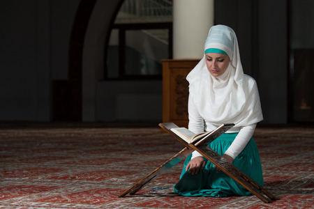 sufi: Muslim Woman Reading Holy Islamic Book Koran