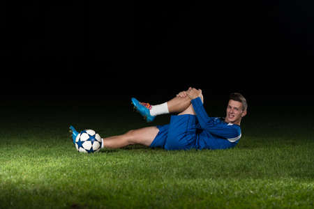 Soccer Player Have Pain Injury Accident On Football Game photo