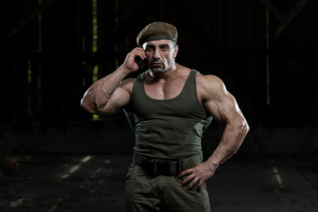 Military Man Talking On Cell Phone photo