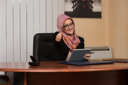 Happy Muslim Business Woman With Thumbs Up Gesture photo