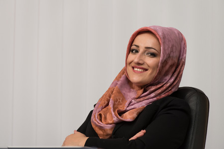 Happy Muslim Businesswoman In The Office photo