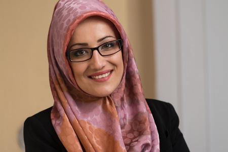 Happy Muslim Businesswoman In The Office Stock Photo