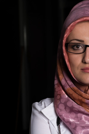 Portrait Half Of Face Of Muslim Doctor photo
