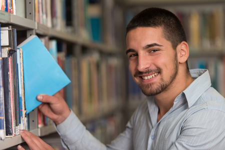 adult education: A Portrait Of An Caucasian College Student Man In Library - Shallow Depth Of Field