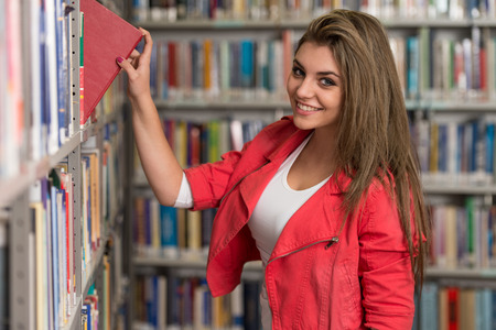 A Portrait Of An Caucasian College Student Girl In Library - Shallow Depth Of Field photo