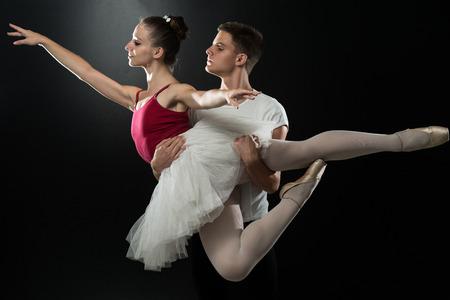 Handsome Couple Ballet Dancer On A Black Background photo