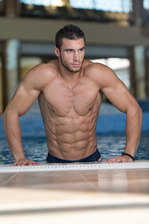 naked male body: Fashion Portrait Of A Very Muscular Sexy Man In Underwear At Swimming Pool Stock Photo