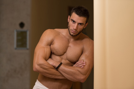 Beautiful Muscular Man With The Towel After Taking Shower In Bath