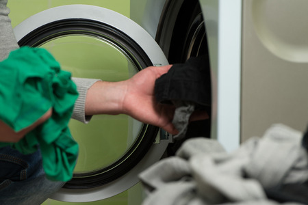 laundry room: Handsome Young Man In The Laundry Room