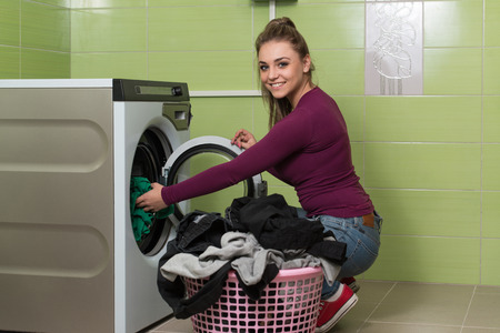 laundry room: Pretty Smiling Girl In The Laundry Room