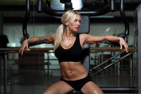 blonde girls: Sexy Blonde Woman Posing In The Gym