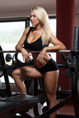 gym clothes: Sexy Blonde Woman Posing In The Gym
