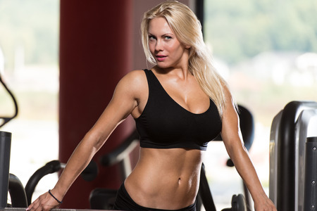 only one girl: Sexy Blonde Woman Posing In The Gym