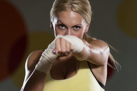 Young Woman Boxer MMA Fighter Practice Her Skills